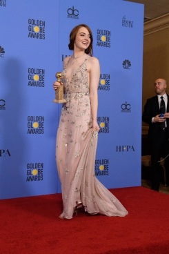 "After winning the category of BEST PERFORMANCE BY AN ACTRESS IN A MOTION PICTURE – COMEDY OR MUSICAL for her work in ""La La Land,"" actress Emma Stone poses backstage in the press room with her Golden Globe Award at the 74th Annual Golden Globe Awards at the Beverly Hilton in Beverly Hills, CA on Sunday, January 8, 2017."