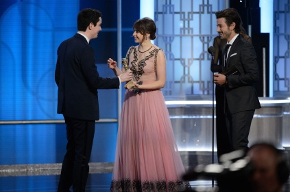 "Damien Chazelle accepts the Golden Globe from Felicity Jones for BEST SCREENPLAY – MOTION PICTURE for ""La La Land"" at the 74th Annual Golden Globe Awards at the Beverly Hotel in Beverly Hills, CA on Sunday, January 8, 2017."