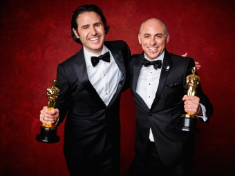 Alan Barillaro and Marc Sondheimer poses backstage with the Oscar® 4Chion Lifestyle
