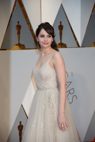Felicity Jones, Oscar® presenter, arrives on the red carpet of The 89th Oscars® at the Dolby® Theatre in Hollywood, CA on Sunday, February 26, 2017.