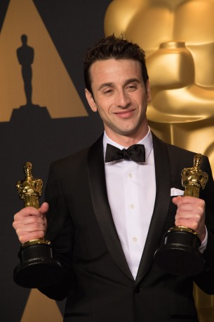 "Justin Hurwitz poses backstage with the Oscar® for Achievement in music written for motion pictures (Original score) and for Achievement in music written for motion pictures (Original song) for ""City of Stars"" for work on ""La La Land"" and during the live ABC Telecast of The 89th Oscars® at the Dolby® Theatre in Hollywood, CA on Sunday, February 26, 2017."