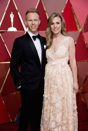 Justin Paul, Oscar® nominee, and guest arrive on the red carpet of The 89th Oscars® at the Dolby® Theatre in Hollywood, CA on Sunday, February 26, 2017.