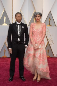 Producers Pharrell Williams and Mimi Valdez arrive on the red carpet at The 89th Oscars® at the Dolby® Theatre in Hollywood, CA on Sunday, February 26, 2017.