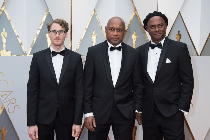 Rémi Grellety, Raoul Peck and Hébert Peck, Oscar® nominees, arrives on the red carpet of The 89th Oscars® at the Dolby® Theatre in Hollywood, CA on Sunday, February 26, 2017.
