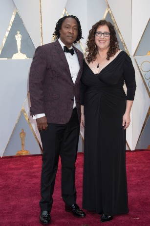 Roger Ross Williams, Oscar® nominee, and Julie Goldman, Oscar® nominee, arrive on the red carpet of The 89th Oscars® at the Dolby® Theatre in Hollywood, CA on Sunday, February 26, 2017.